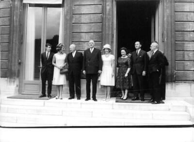 """American politician Dwight David """"Ike"""" Eisenhower standing with others and facin"""