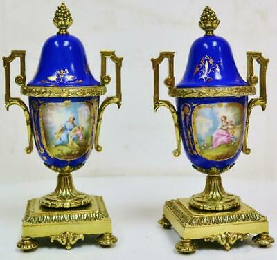 Rare Pair Of Antique French Gilt Bronze & Blue Sevres Porcelain Clock Garnitures