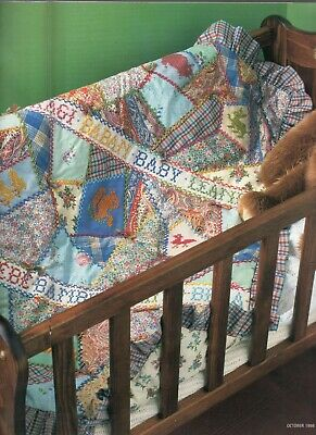 Crazy patchwork cot quilt with cross stitch for baby. By Janet Haigh