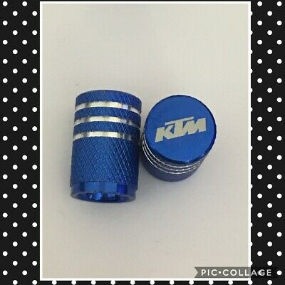 KTM wheel valves pair ktm blue  engraved universal dust caps