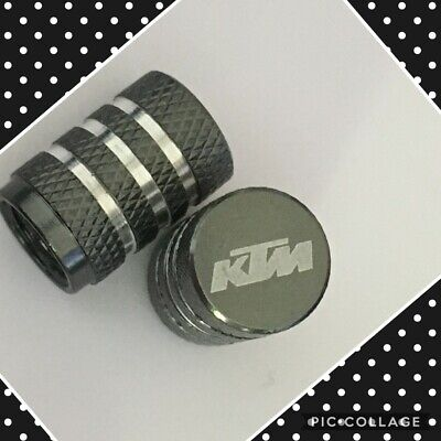KTM wheel valves pair ktm grey engraved universal dust caps