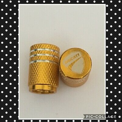 yellow Ducati wheel valves pair motorbike engraved universal dust caps