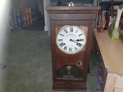 National Time Recorder clocking in wall clock with good working movement