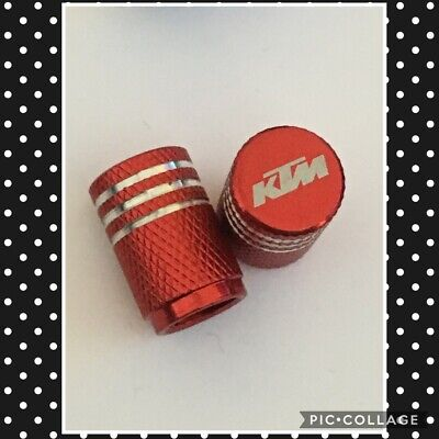 KTM wheel valves pair ktm red engraved universal dust caps