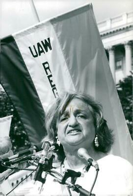 Photograph of Betty Friedan speaks during a march