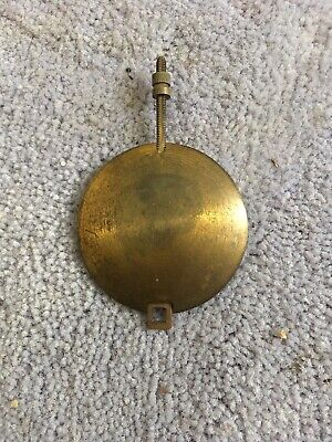 A Brass Pendulum From An Old  Clock