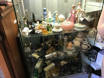 VINTAGE COLLECTION OF AVON PERFUME BOTTLES  , 100 + Bottles of Various  Shapes