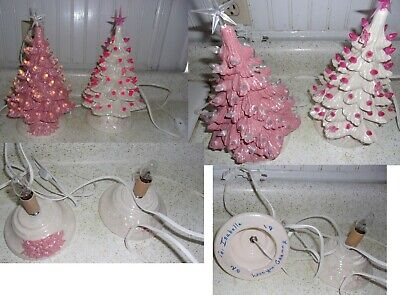 2 Cute Ceramic Lighted Christmas Trees.  One Pink, One White.  About 10 inches