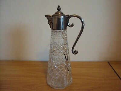 A Glass Claret Jug With Silver Plated Lid And Handle