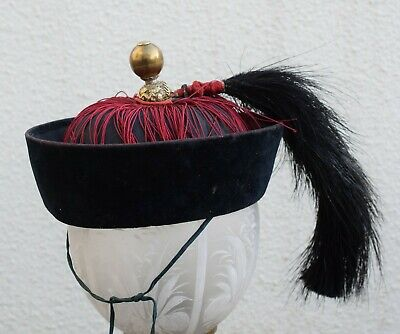An antique Chinese Qing Dynasty winter hat, Mandarin hat finial