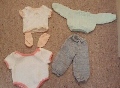 Hand knitted dolls clothes. 5 items. Pre owned. VGC. Fit doll aprox upto 48cm