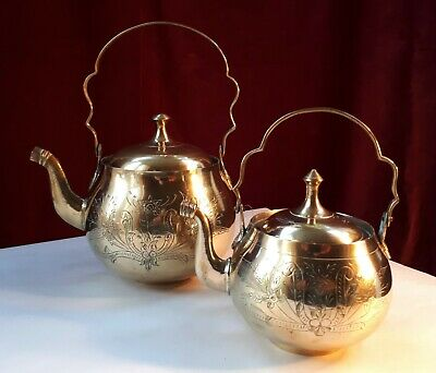 Graduated Pair of Brass Stove-Top Kettles with Articulating Handles. Home Decor