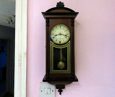 A Vintage 31 Day Mechanical Wall Bracket Clock