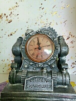 Antique and Old Fashioned Mini Desk Clock With Gray Color  A very old fashioned