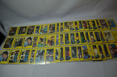 Lot of 140 - 1984 Topps Gremlins Trading Cards in plastic sleeves