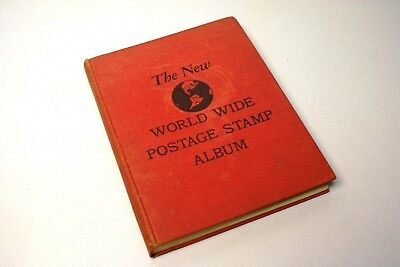 1958 first printing Worldwide postage stamp album book with + 600 stamps.