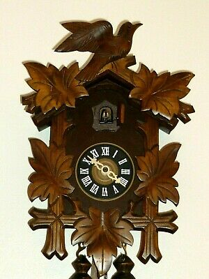 WOODEN CUCKOO CLOCK BLACK FOREST MADE IN GERMANY: REGULA. in good working order