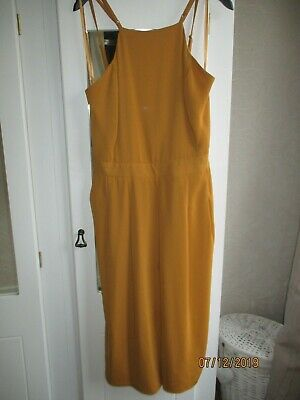River Island mustard strappy jumpsuit size 14