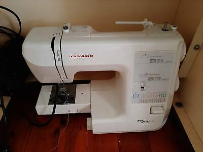 Horn sewing cabinet with Janome machine and overlocker