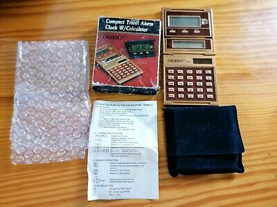 compact travel alarm clock w/calculator orient oc-504 en caja funda y folleto