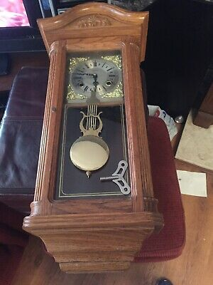 Pendulum wall clock wooden by Highlands (Restoration required)