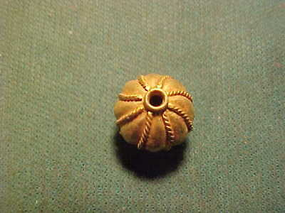 Decorated  Sasanian solid  gold bead circa 224-642 AD.
