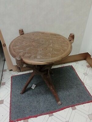 Hand Carved Folded Wooden Stool With Elephants on both sides 48cm high 36 wide