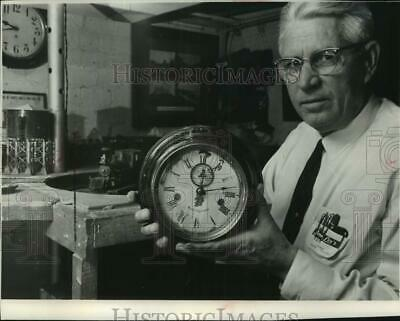 1966 Press Photo Railroad Collector Wesley Foshay with clock in Wisconsin