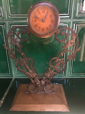 antique clock holder brass base the clock not working only parts or restoration