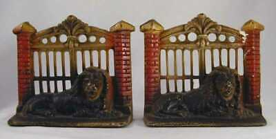 Antique Cast Iron Bookends Lion in Front of Metal Gate