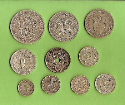#C25.  #1. Lot Of Ten(10) Circulated  World Silver Coins