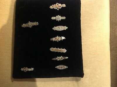 Nine antique silver sweetheart brooches