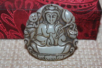 Chinese hand carved nobleman wearing white jade pendant