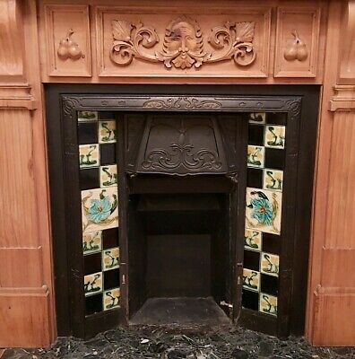 Antique cast iron fireplace insert with hand painted tiles. Reclaimed