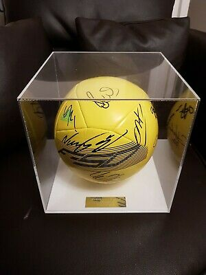 Manchester United signed football in display case.