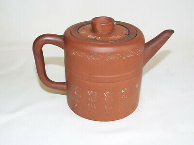 Antique Chinese red clay Yixing teapot with impressed symbols, a/f.