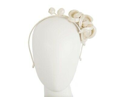 Cream leather flower winter racing fascinator by Max Alexander. RRP: $119.95