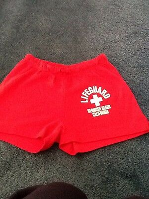 Girls red shorts . Size S. logo on front. new no labels ..