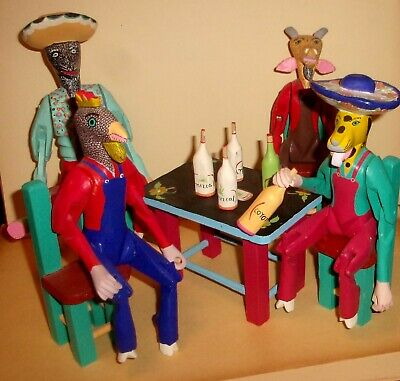 Vintage Set of 4 Inocencio Vasques Wood Crafted Jointed Animals with Bottles