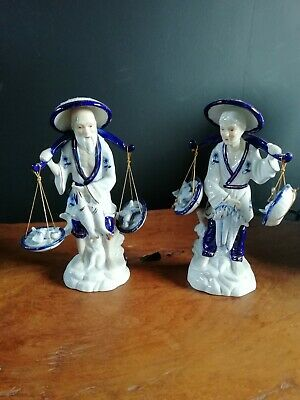 Chinese fishmongers porcelain figurines blue and white for good luck . 19.5 cm