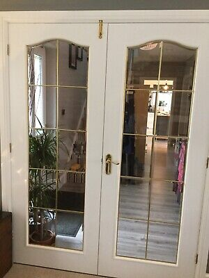 White Painted Internal Double Doors With Bevelled Glass Panels And Brass Trim