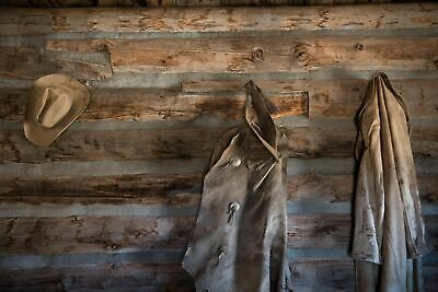 """Photo of Coats and a cowboy hat at the """"Hole-in-the-Wall"""" Cabin at Old Trail  n"""