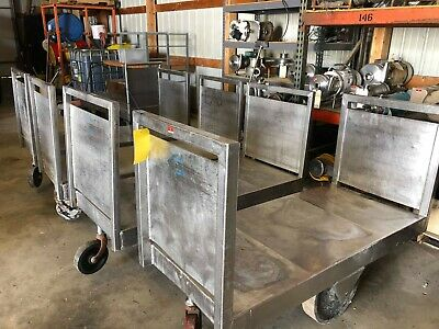 """Used stainless steel cart, on casters, overall dimensions 61""""L x 24""""W x 42""""H"""