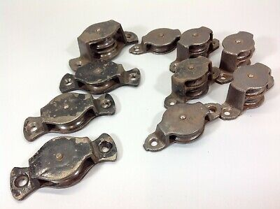 Quantity of Vintage or Antique Cast Iron Wall Mount Pulleys