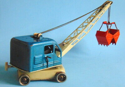 Vintage 1960s retro blue and white pressed steel crane by GAMA. West Germany