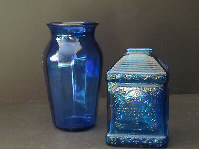 Two vintage items: cobalt blue glass coin bank and vase