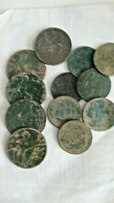 selection of 1 penny and half penny coins and a 10p