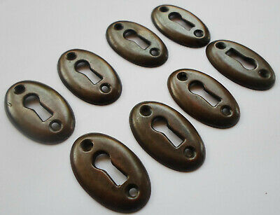8 Vintage Stamped Iron Brown Color Keyhole covers Unused Old Stock