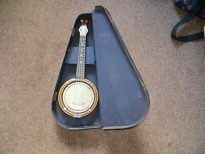 Banjo ukulele in good playing condition  complete with vintage hard case.