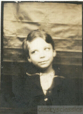 1927 Young Boy Looks Over Sweet Sweater Photo booth